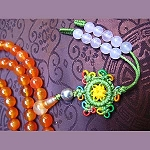 Orange Agate Mala with Crocheted Dharma Wheel